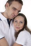 Hombre y mujer en el aislamiento blanco Imagenes de archivo