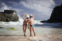 Hombre y mujer en la playa Imagen de archivo