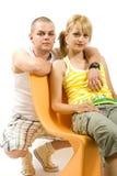 Hombre y mujer en silla Foto de archivo libre de regalías