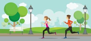 Hombre y mujer que corren en el parque Imagen de archivo