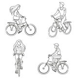 Hombre y mujer que montan una bicicleta Fotografía de archivo libre de regalías