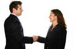 Hombre y mujer que sacuden las manos Imagen de archivo