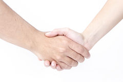 Hombre y mujer que sacuden las manos, aisladas en blanco Foto de archivo