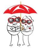 Hombre y mujer que se colocan con el paraguas Imagen de archivo