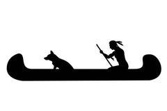 Hombre y perro indios en canoa Imágenes de archivo libres de regalías