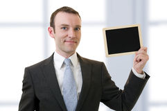 Hombre y pizarra Imágenes de archivo libres de regalías
