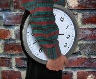 Hombre y reloj Foto de archivo libre de regalías