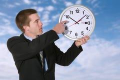 Hombre y reloj de negocios Foto de archivo libre de regalías