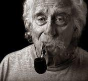 Hombre y su tubo Fotos de archivo libres de regalías