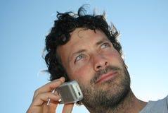 Hombre y teléfono Imagen de archivo libre de regalías