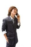 Hombre y teléfono asiáticos de negocios Imagen de archivo libre de regalías