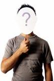 Hombre y una máscara del signo de interrogación Imagen de archivo