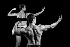 Hombre y una mujer en la gimnasia Fotografía de archivo libre de regalías