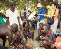 Hombres africanos y turismo Foto de archivo