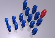 Hombres azules que forman una flecha Imagenes de archivo