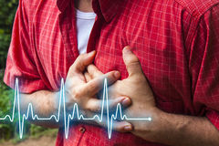 Hombres con el dolor de pecho - ataque del corazón Imagen de archivo libre de regalías