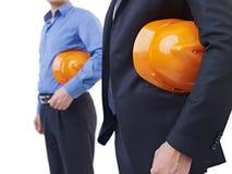 Hombres con el sombrero de seguridad anaranjado Imagen de archivo libre de regalías