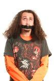 Hombres con la cinta adhesiva en boca Fotos de archivo