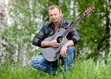 Hombres con la guitarra Fotos de archivo libres de regalías