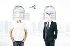 Hombres con las cabezas de la jaula Fotografía de archivo