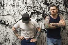 Hombres con los tatuajes. Imagen de archivo libre de regalías