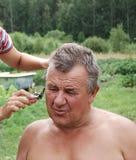 Hombres de Barbering Imágenes de archivo libres de regalías