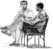 Hombres de conversación Imágenes de archivo libres de regalías