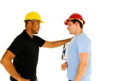 Hombres de la construcción fotos de archivo