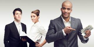 Hombres de negocios acertados jovenes Imagen de archivo libre de regalías