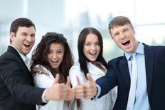 Hombres de negocios acertados que parecen felices y confiados Imágenes de archivo libres de regalías