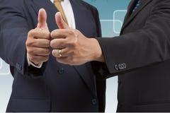 Hombres de negocios con el pulgar para arriba Foto de archivo