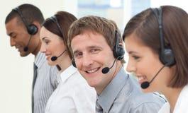 Hombres de negocios con el receptor de cabeza encendido Imagen de archivo libre de regalías