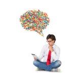 Hombres de negocios con la almohadilla táctil Imagen de archivo libre de regalías