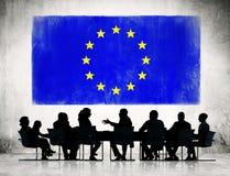 Hombres de negocios con la bandera de unión europea ilustración del vector