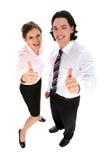 Hombres de negocios con los pulgares para arriba Foto de archivo libre de regalías