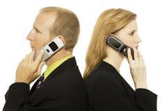 Hombres de negocios con los teléfonos Fotos de archivo libres de regalías