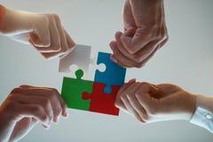 Hombres de negocios de la colaboración Team Concept del rompecabezas fotos de archivo