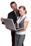 Hombres de negocios de la computadora portátil Imagenes de archivo