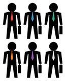 Hombres de negocios de la silueta con los iconos coloreados del lazo Fotografía de archivo