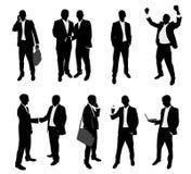Hombres de negocios de las siluetas Imagen de archivo libre de regalías