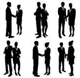 Hombres de negocios de las siluetas del apretón de manos Imagen de archivo