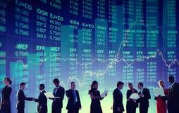Hombres de negocios de los conceptos financieros globales Foto de archivo libre de regalías