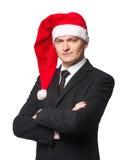 Hombres de negocios de Papá Noel en traje con los brazos cruzados Imagenes de archivo