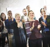 Hombres de negocios de Team Applauding Achievement Concept Foto de archivo