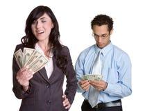 Hombres de negocios del dinero Fotos de archivo