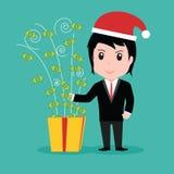 Hombres de negocios del dinero de la caja de regalo, día de fiesta de la Navidad Fotos de archivo