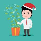 Hombres de negocios del dinero de la caja de regalo, día de fiesta de la Navidad Fotos de archivo libres de regalías