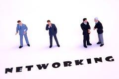 Hombres de negocios del establecimiento de una red Foto de archivo libre de regalías