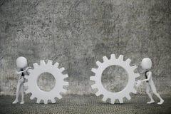 hombres de negocios del hombre 3d que empujan dos ruedas de engranaje Imagenes de archivo