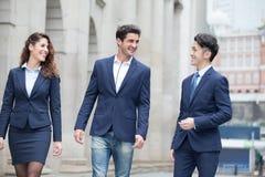 Hombres de negocios del paseo en el camino Imagen de archivo libre de regalías